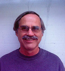photo of a man with eyeglasses and a moustache