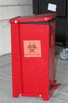 a biohazard refuse container, with a step-on button for the lid