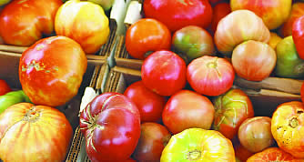 photo of heirloom tomatoes in a basket