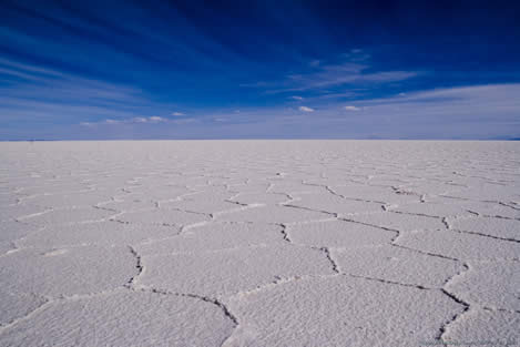 photo of a salt flat under a blue sky