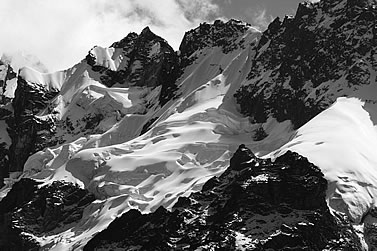black-and-white photo of high mountain crags and ice