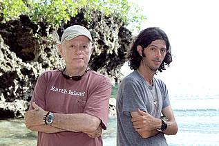 photo of two men, an older and a younger, in front of an ocean cove