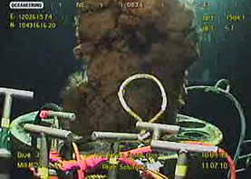 screen capture of the macondo wellhead from underwater, oil gushing