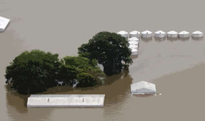 photo of a flooded landscape, roofs just topping the water level