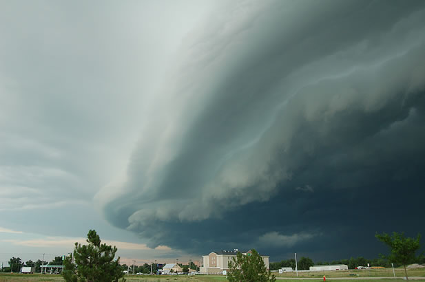 photo of a large stormcloud over a landscape