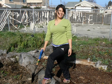 photo of a young woman in an urban garden