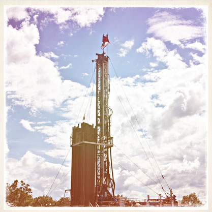 faded image of a fracking tower