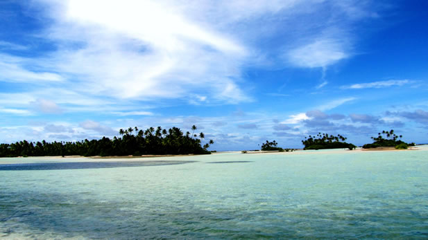 photo of a tropical island and clear water