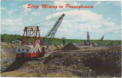 photo of heavy equipment and a mine, farmfields nearby; postcard-like script reads, Strip Mining in Pennsylvania