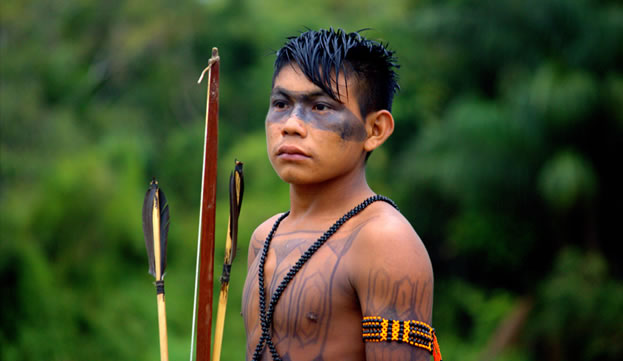 photo of a young man with facepaint, holding a bow and arrows