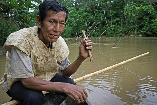 photo of a man, fishing in a tropical river, unhappy