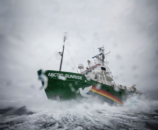 photo of a ship moving through rough sea