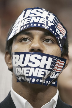 photo of a man wearing bush-cheney 04 stickers on his head and over his mouth