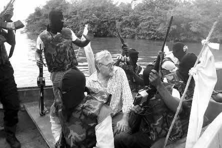 photo of a man on a boat, surrounded by masked men with guns