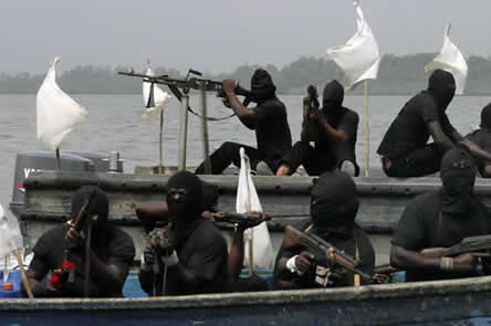 photo of men in masks with mounted machine guns, river in the background
