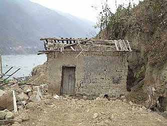 photo of a ruinous building, with a misty body of water behind