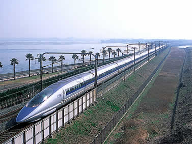photo of a sleek train on a coastal track