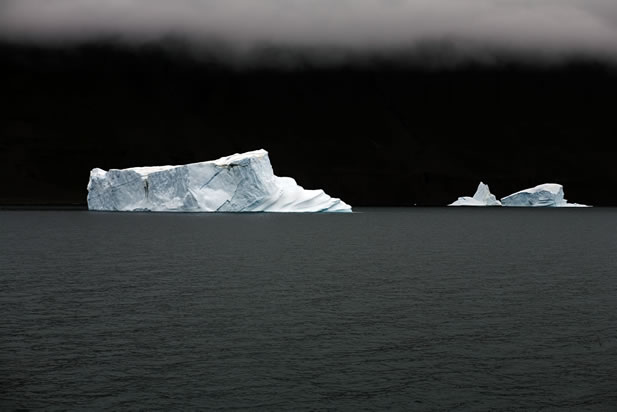 photo of icebergs on a dark sea