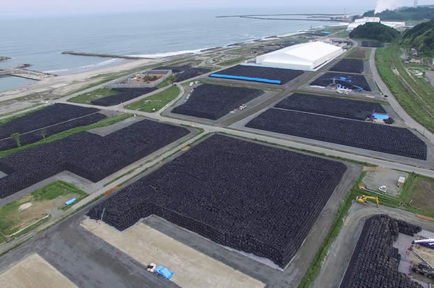 aerial photo of a coastal industrial site, covered with full bags