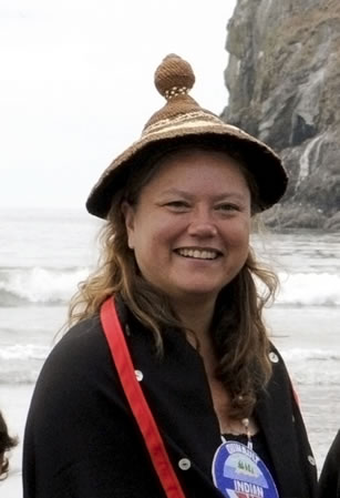 photo of a woman, smiling and wearing a hat