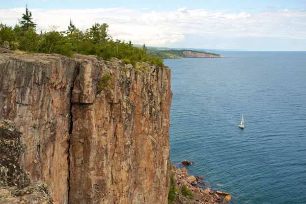 photo of a cliff large body of water below