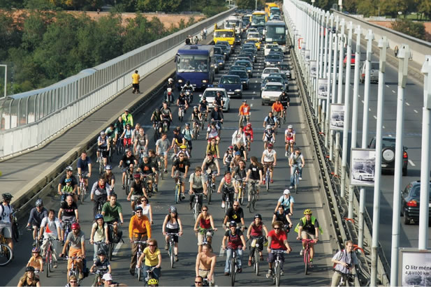 cyclists on a bridge