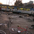 photo of bikes on the ground near a train station