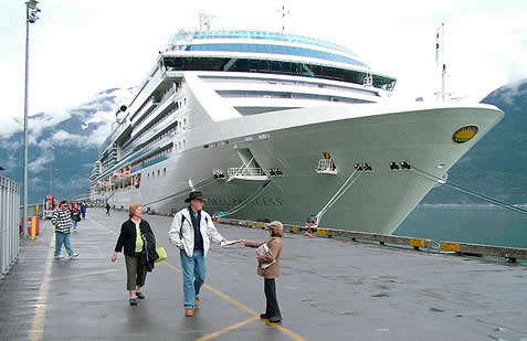 cruise ship in dock photo, leafletter speaking with friendly passengers