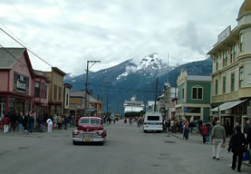 South view of Broadway at 3rd street, Skagway, Alaska; Cruise ship visible at street end