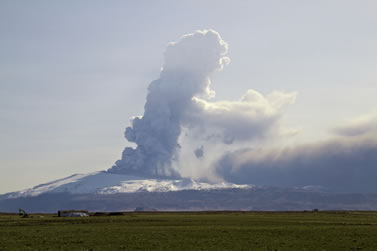 photo of an erupting volcano