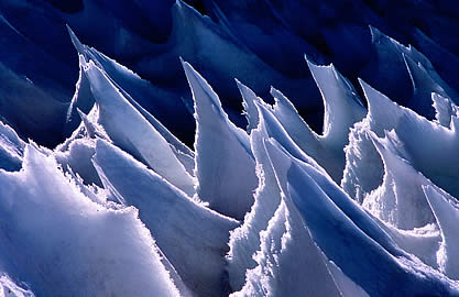 detail photo of a dramatic ice-scape; wave-like forms with sharp peaks