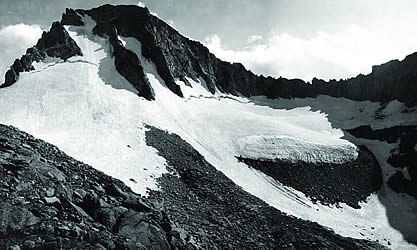 older photo of a glacier-clad peak