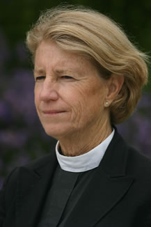 photo of a woman's face, she's wearing a clerical collar