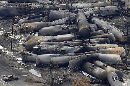 photo of burned railcars in a heap
