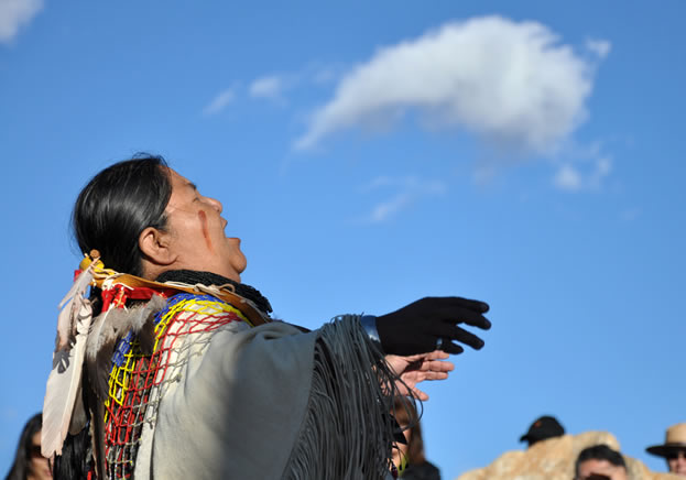 photo of a woman looking skyward and singing