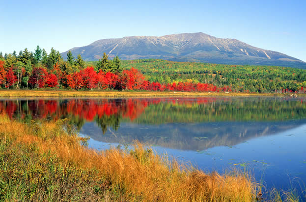 photo of a lake and mountian, forest in full Autumn color in the middle distance
