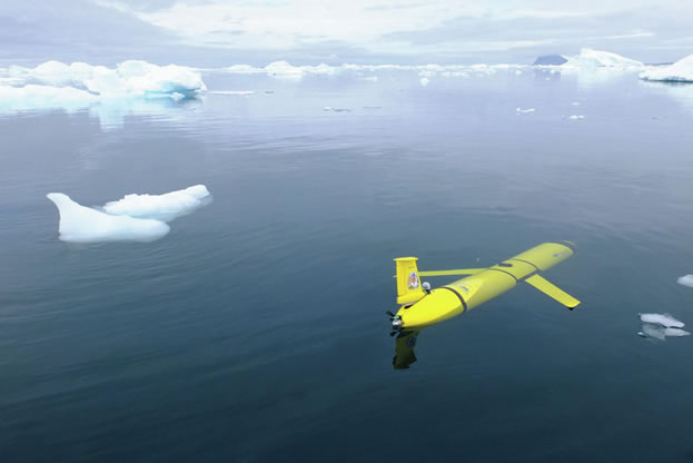 photo of a submersible craft in ice-strewn ocean water