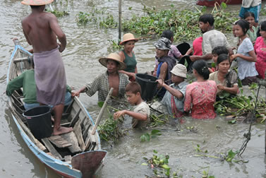 photo of a group of people evacuating in a flook