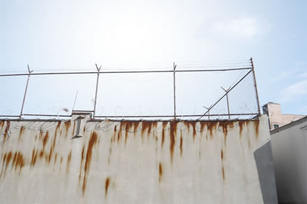 photo of  a prison wall and fence