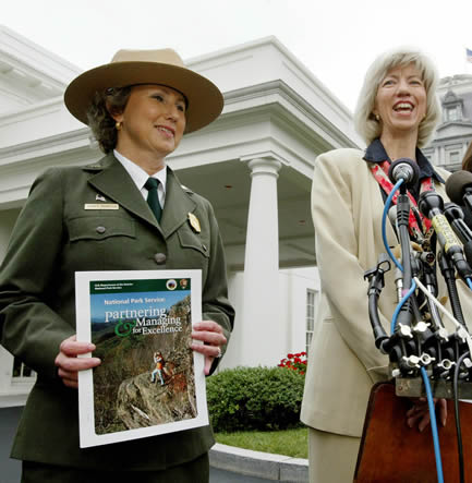 Interior Secretary Glae Norton (right) and National Parks Service Director Fran Mainella talk to press following a meeting with George W. Bush at the White House, July 2, 2003. Norton and Mainella presented the president with a report on national parks. — REUTERS/Larry Downing