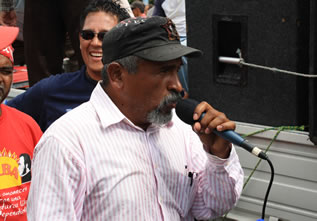 photo of a man speaking into a microphone