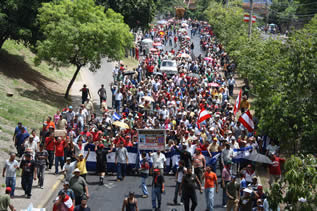photo of a city street filled with demonstrators all the way to the horizon