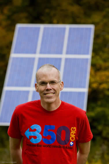 photo of a man, solar panel in background