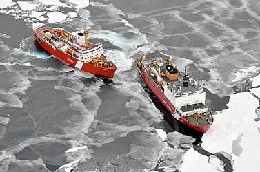 photo of two ships in ice-filled waters