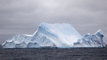 photo of an iceberg on the sea
