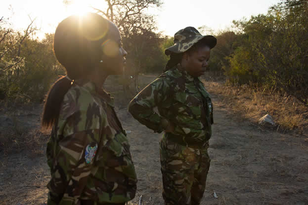 photo of two women in military camouflage outdoors
