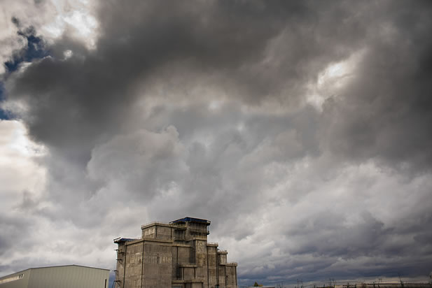 photo of the sarcophagus, a building with no windows, under a threatening sky