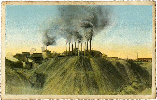 postcard-like image of an industrial scene, coal and smoke