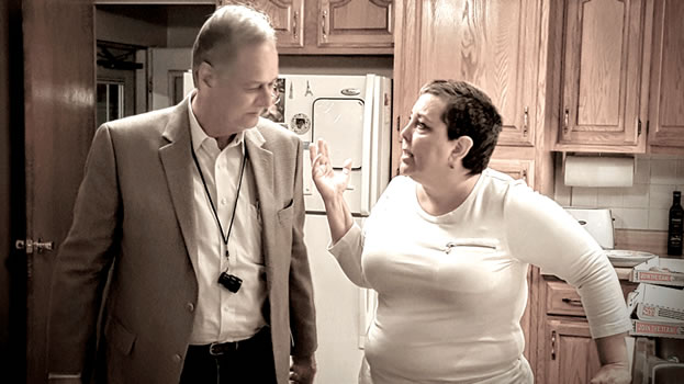 photo of a woman and a man talking in a kitchen