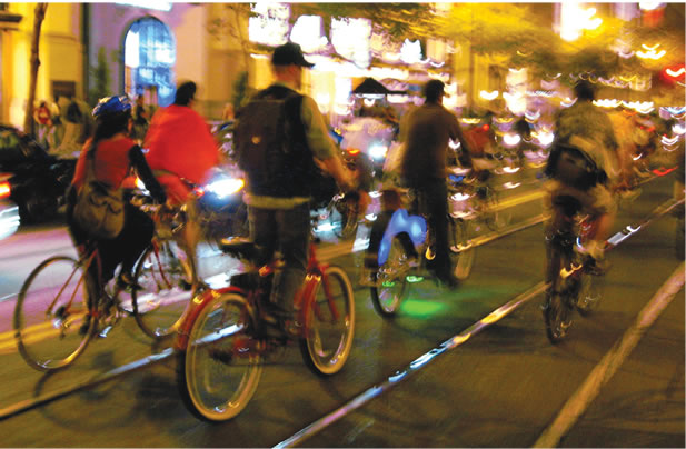 photo of cyclists at night